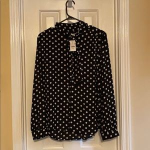 Black and while polka dot tie-neck blouse